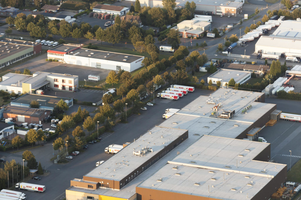 Commercial New Roof Installation Brooklyn Park MN - Aerial Shot of a Flat Roof