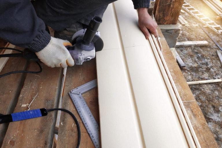 Siding Company Brooklyn Park MN & Brooklyn Center MN - A Man Working on a Roof